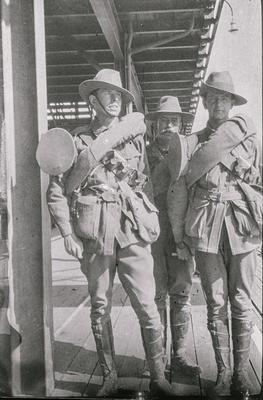 Photographic negative - three soldiers