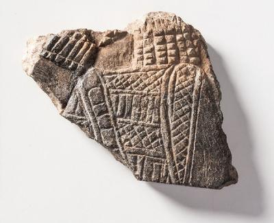 Fragment of Assyrian wall panel with archer scene