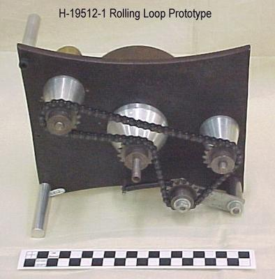 Rolling Loop Film Transport Mechanism