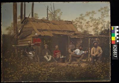 Photograph - Miner's Bush Hut (Sunday Afternoon. Miners relaxing in front of slab and bark hut)