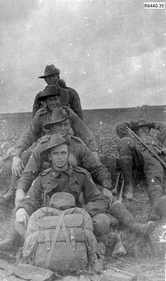 Photograph - Australian Soldiers resting during Route March; R6440.35